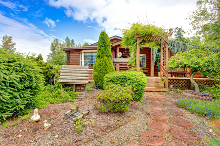 Log cabin style house exterior with curb appeal. Wooden house with walkout deck Stock Photo