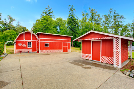 sheds: Farm style storage sheds in bright red color with white trim