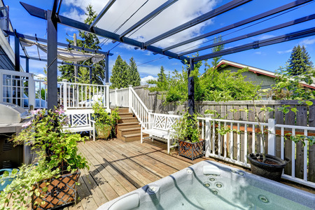 Walkout Deck With Jacuzzi And Pergola. Patio Area With Barbecue Stock  Photo, Picture And Royalty Free Image. Image 34354304.