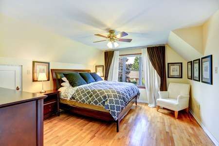 queen bed: Master bedroom interior with beautiful queen size bed and white armchair in the corner