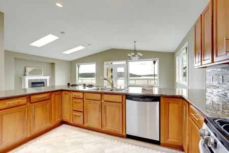 appliances: Luxury kitchen room with bright brown cabinets and built-in appliances