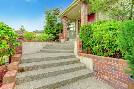 Entrance porch with brick columns and stairs Stock Photo
