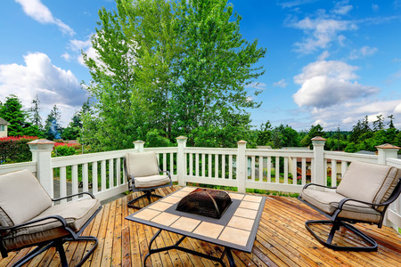 Beautiful walkout patio with firepit and chairs