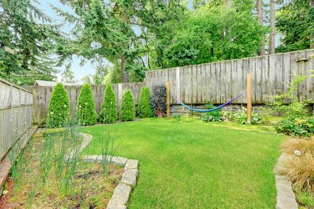 Backyard landscape design with stone trimmed flower beds