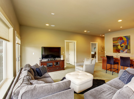 Secondary Living Room With Carpet White Ottoman And Bar. Stock Photo ...
