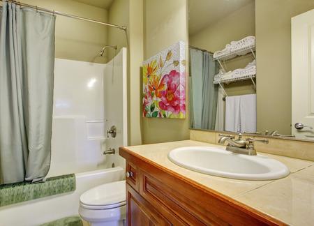 bathroom tile: Bathroom with tile floors showerbath.
