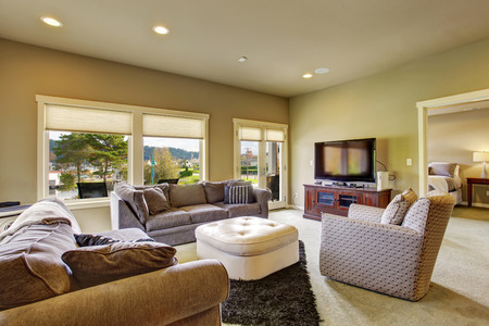 secondary Living room with carpet windows and water view.