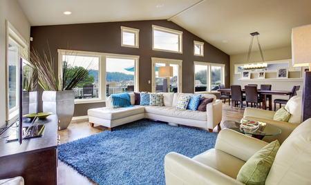 blue leather sofa: Huge living room interior with many windows and white leather sofa