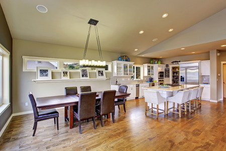 furnished: Beautiful bright furnished dinning room with windows and wooden floor. Stock Photo