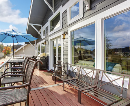 northwest: Northwest traditional wooden deck with water veiw. windows and chairs. Stock Photo