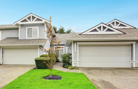 curb appeal: Modern northwest home with garage and grass yard.