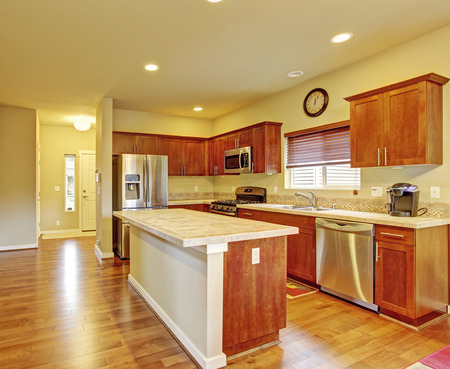 kitchen island: Classic kitchen with hardwood floor, island, and window.