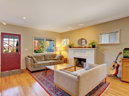 Traditional living room with fire place and sofas. Stock Photo