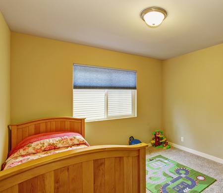 kids' room: Kids room with carpet, window, and twin bed.