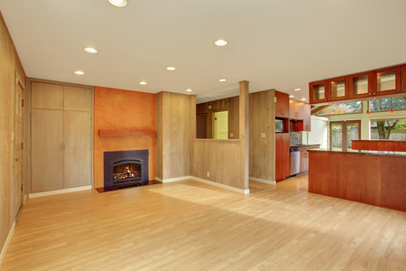 Nice living room with hard wood floor and fireplace. Stock Photo