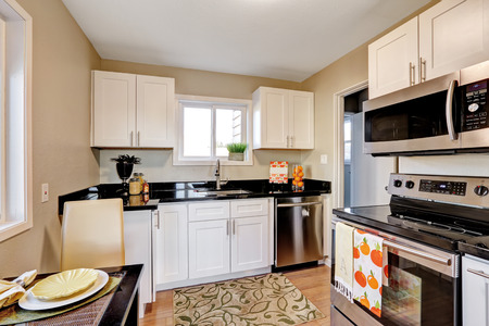 clean home: Nice kitchen with windows and black counters.