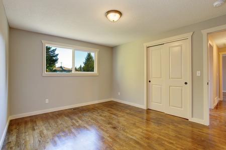 simplistic: Simplistic hardwood bedroom with great lighting and closet. Stock Photo