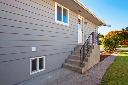 northwest: Side door with steps to modern northwest house. Stock Photo