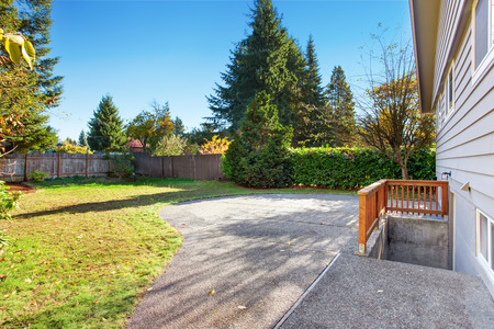 back yard: Larde back yard with patio and lots of grass. Stock Photo
