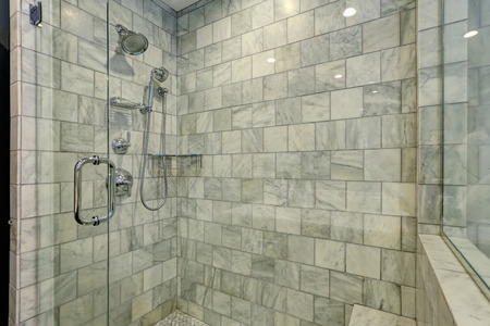 bathrooms: Luxury white and grey marble bathroom interior.