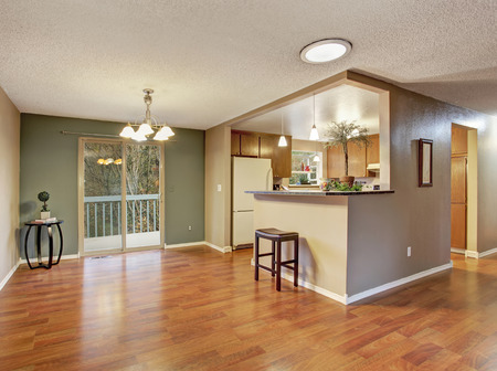 dinning room: Nice sized dinning room with hardwood floor and stool. Stock Photo