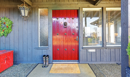 Perfect house red door with grey walls and boots.