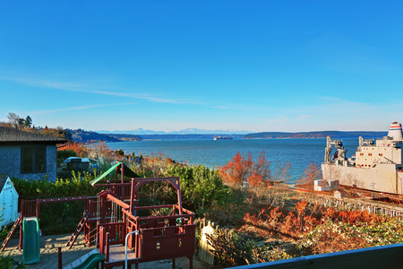 rambler: Grey rambler with winter landscape and water view. Tacoma, WA.