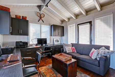 Bright beautiful home office interior design with classic American style.