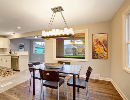 dinning room: Elegant dinning room with connected kitcen and hardwood floor. Stock Photo