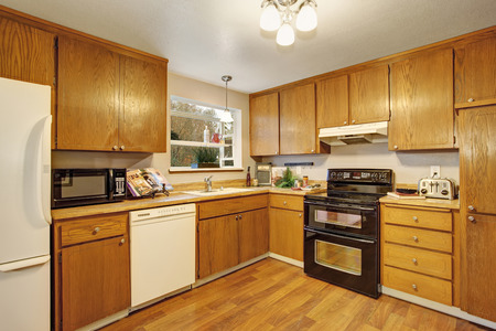 cabinets: Traditional kitchen with hardwood floor, cabinets, and bar.