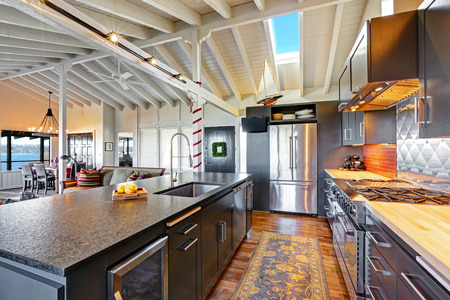 ceiling: Luxury beautiful dark modern kitchen with vaulted wood ceiling, hardwood floor and huge stove.