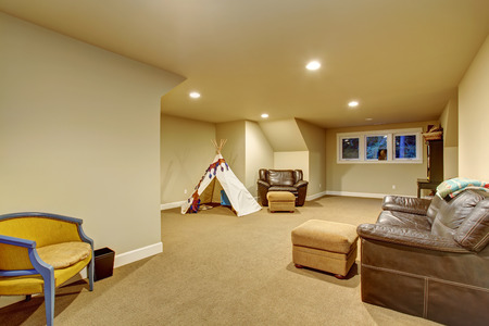 Large childerns play room with carpet, and windows.