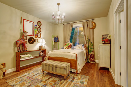 chandelier  kids: Colorful kids room with decor and hardwood floor and window.