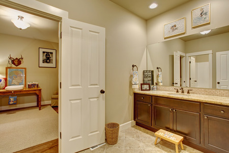 a toilet stool: Classic tile floor bathroom connected to bedroom.