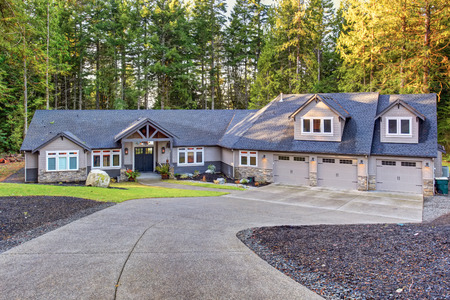 garage on house: Beautiful large house with driveway, and garage.