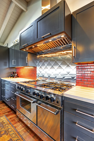 the vaulted: Luxury beautiful dark modern kitchen with vaulted wood ceiling, hardwood floor and huge stove.