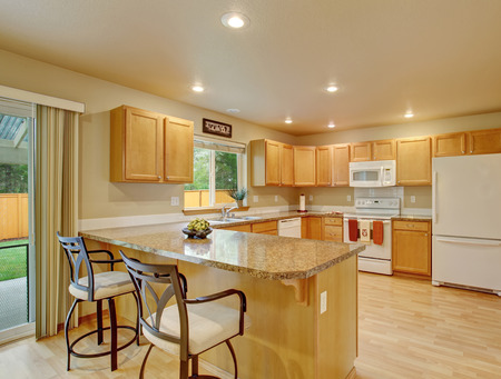 kitchen cabinets: Traditional kitchen with hardwood floor and windows.