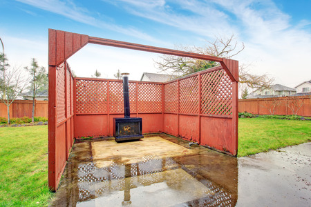 outdoor fireplace: Nice outdoor fireplace area with fence.