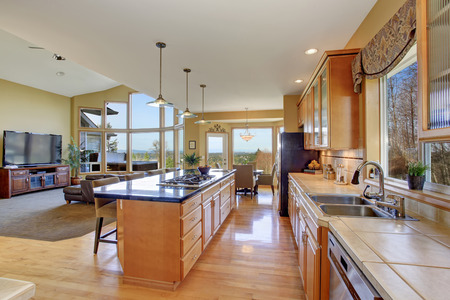 large: Gorgeous kitchen in perfect traditional home, with large island and light toned hardwood floor.