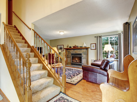 hardwood floor: elegant entry way with stairs and hardwood floor.