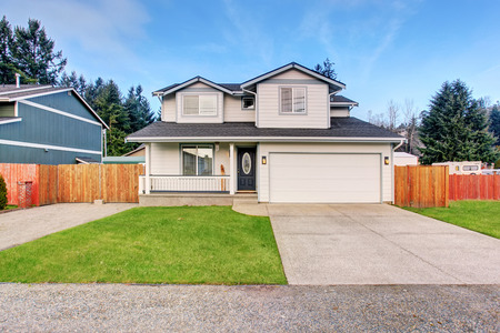 driveways: Traditional northwest home with driveway and grass.