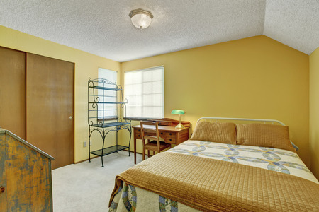 simplistic: Simplistic bedroom with carpet floor and bed. Stock Photo