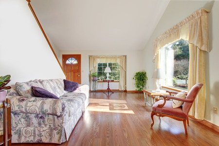 living room wall: Modern entry way with stairs, hardwood floor and dinning room.