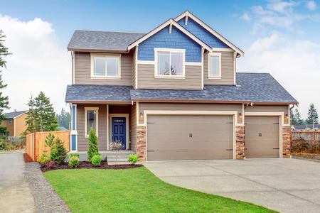 front view: Beautiful traditional home with garage and driveway. Stock Photo