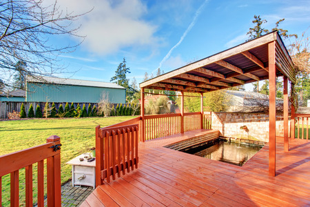 back yard: Large back yard with lots of grass, garden area and covered back deck.