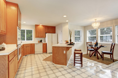 wooden furniture: Complete kitchen with tile floor and windows. Stock Photo