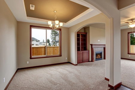 carpet: Lovely unfurnished living room with carpet and fireplace.