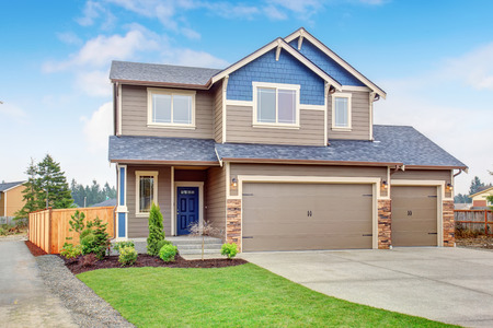 driveway: Beautiful traditional home with garage and driveway. Stock Photo