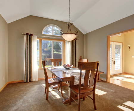 northwest: Traditional dinning room with tan carpet in beautiful northwest home.