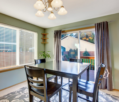 put together: Well put together dinning room with sliding glass door, window and modern decor rug.